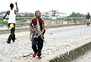 A child Liberian government gunman at the 'Old Bridge' returns from firing across at (LURD) Liberians United for Reconciliatrion and Democracy rebels  on the other side Monrovia 30 July 2003.This the Twelveth day of continued fighting for the capital despite the call for ceasefire. Battles are centred around the New, Old and Stockton bridges leading into the city.<br /> EPA PHOTO/NIC BOTHMA