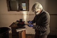 Jeanette looks through some personal possessions as she and others clean her home in Far Rockaway, NY November 6, 2012 following the severe devastation from Superstorm Sandy.  Photo Ken Cedeno