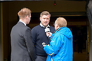 MK Dons manager Karl Robinson conducts a pre match radio interview during the Sky Bet Championship match between Milton Keynes Dons and Brentford at stadium:mk, Milton Keynes, England on 23 April 2016. Photo by Dennis Goodwin.