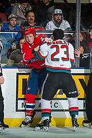 KELOWNA, CANADA - MARCH 3: Colum McGauley #23 of the Kelowna Rockets drops the gloves with Riley McKay #27 of the Spokane Chiefs on March 3, 2018 at Prospera Place in Kelowna, British Columbia, Canada.  (Photo by Marissa Baecker/Shoot the Breeze)  *** Local Caption ***