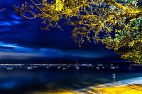 Pescador na Praia de Santo Antonio de Lisboa ao anoitecer. Florianópolis, Santa Catarina, Brasil. / Fishingman in Santo Antonio de Lisboa Beach at evening. Florianopolis, Santa Catarina, Brazil.