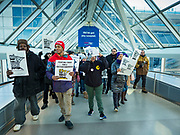 28 FEBRUARY 2020 - MINNEAPOLIS, MINNESOTA: Striking members of the SEIU Local 26 walk into the main terminal during a strike picket at  the Minneapolis St. Paul International Airport. The striking workers did not disrupt passengers and flights. About 4,000 janitorial and custodial workers represented by the Service Employees International Union (SEIU) Local 26 in the Twin Cities are on an Unfair Labor Practices (ULP) strike for better wages and benefits. Friday morning they picketed  the Minneapolis-St. Paul International Airport Friday morning.          PHOTO BY JACK KURTZ