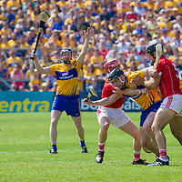 Clare's Tony Kelly is held back by Cork's Daniel Kearney and Christopher Joyce