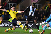 Oxford United defender Sam Long (12) battles for possession  with Newcastle United midfielder Allan Saint-Maximin (10) during the The FA Cup match between Oxford United and Newcastle United at the Kassam Stadium, Oxford, England on 4 February 2020.