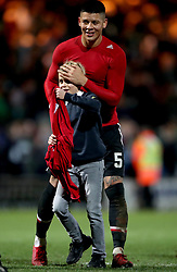A young fan with Manchester United's Marcos Rojo and his shirt after the final whistle during the Emirates FA Cup, fourth round match at Huish Park, Yeovil.