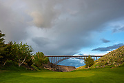 Landscape of amazing skies and clouds on a beautful stormy spring night during sunset over the Perrine Bridge in the Snake River Canyon of Twin Falls, Idaho.