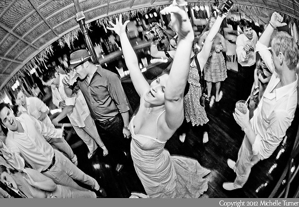 The bride celebrates at her Puerto Vallarta Wedding.  Image by Puerto Vallarta Wedding Photographer Michelle Turner.