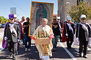 """10 OCTOBER 2010 - PHOENIX, AZ:  JUAN JAUREGUI, from Phoenix, AZ, portrayed Juan Diego during a procession in Phoenix, AZ, Sunday. Juan Diego is the Mexican peasant who first saw the Virgin of Guadalupe in 1531 in what is now Mexico City. About 500 people processed through downtown Phoenix Sunday afternoon to honor the Virgin of Guadalupe, the """"Queen of the Americas."""" The procession was accompanied by 12 Matachine dance troupes. The Matachines are an important part of Mexican Catholic culture. They represent the battle of Good vs. Evil and the protect the Virgin from malevolent forces, represented by the demon like figures who accompany the dancers.      Photo by Jack Kurtz"""