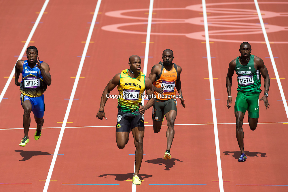 04.08.2012 Stratford, England. Jamaicas Asafa Powell (JAM) wins his heat in Round 1 of the Mens 100m during the Athletics on Day 8 of the London 2012 Olympic Games at the Olympic Stadium.