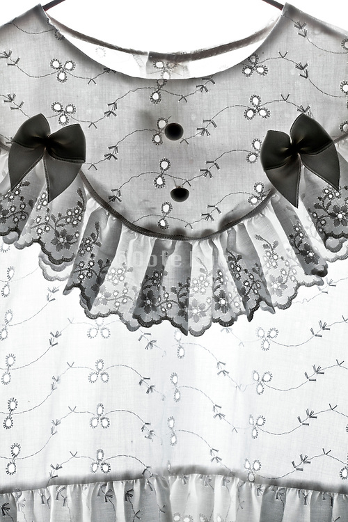 detail of a ornamental  children dress with embroidery