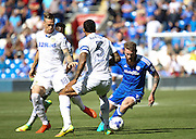 Aron Gunnarsson of Cardiff City dribbles past Kyle Bartley of Leeds Unitedduring the EFL Sky Bet Championship match between Cardiff City and Leeds United at the Cardiff City Stadium, Cardiff, Wales on 17 September 2016. Photo by Andrew Lewis.