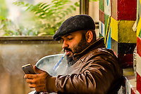 Man smoking sheesha (waterpipe), Al-Rasheed Court Cafe (a.k.a. Eco-tourism Cafe), Downtown Amman, Jordan.