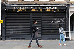 Edinburgh, Scotland, UK. 2 July, 2020. Because no tourists can travel to the UK, tourist shops on the normally busy Royal Mile in Edinburgh Old Town remain shut and boarded up. Streets are still mostly deserted since few locals live in the area. Pictured; Whisky shop is closed. Iain Masterton/Alamy Live News