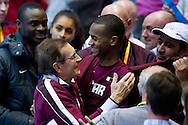 (R) Mutaz Essa Barshim of Qatar and his trainer coach Stanislaw Szczyrba from Poland (L) celebrate gold medal in men's high jump final during the IAAF Athletics World Indoor Championships 2014 at Ergo Arena Hall in Sopot, Poland.<br /> <br /> Poland, Sopot, March 9, 2014.<br /> <br /> Picture also available in RAW (NEF) or TIFF format on special request.<br /> <br /> For editorial use only. Any commercial or promotional use requires permission.<br /> <br /> Mandatory credit:<br /> Photo by © Adam Nurkiewicz / Mediasport