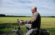 senior 80+ male person bicycling Holland