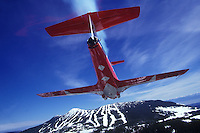 #4 Snowbird flying in formation passes over the Mt. Washington ski hill.  Courtenay, The Comox Valley, Vancouver Island, British Columbia, Canada.