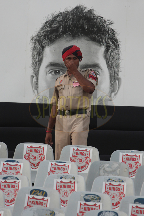 A policeman during match 54 of the Indian Premier League ( IPL ) Season 4 between the Kings XI Punjab and the Mumbai Indians held at the PCA stadium in Mohali, Chandigarh, India on the 10th May 2011..Photo by Anil Dayal/BCCI/SPORTZPICS