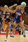 Temepara George grabs the pass under pressure from Keirra Trompf ~ Netball action from ANZ Championship Grand Final - Queensland Firebirds v Northern Mystics - played at the Brisbane Convention Centre on Sunday 22nd May 2011 ~ Photo : Steven Hight (AURA Images) / Photosport