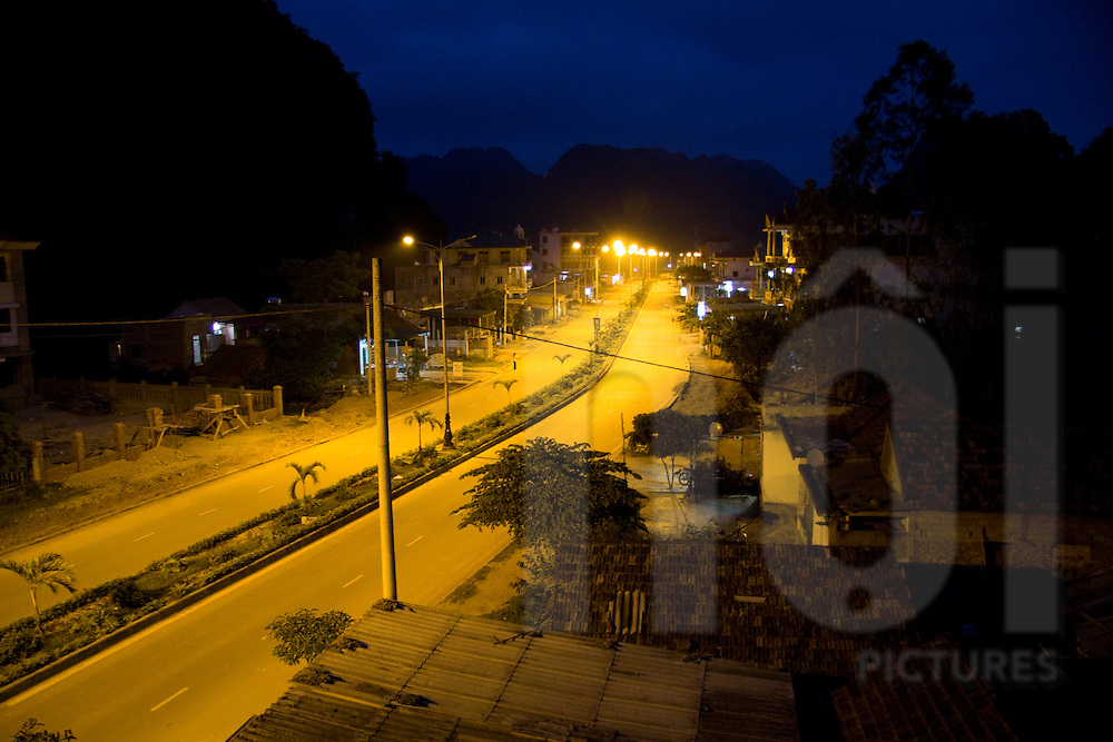Empty avenue of a small city by night. Quang Binh province, Vietnam, Asia