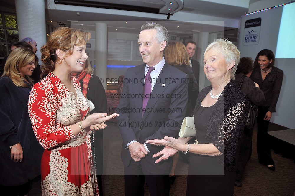 Left to right, HRH PRINCESS HAYA OF JORDAN, Trainer JIM BOLGER and his wife JACKIE at the launch of the 2009 Derby Festival in the presence of HRH Princess Haya of Jordan in aid of the charity Starlight held at the Kensington Roof Gardens, 99 Kensington High Street, London W8 on 12th May 2009.