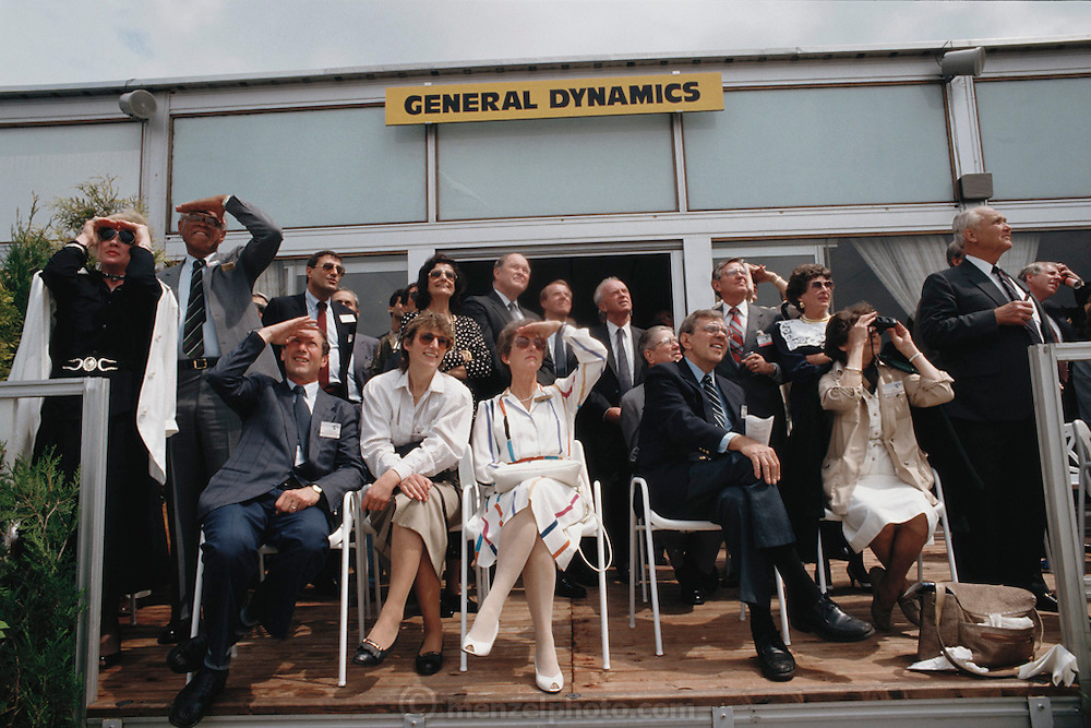 General Dynamics guests watching F-16C fly at the Paris Air Show, at Le Bourget Airport, France. Held every other year, the event is one of the world's biggest international trade fairs for the aerospace business.