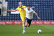 Preston North End Defender Greg Cunningham challenged during the Sky Bet Championship match between Preston North End and Milton Keynes Dons at Deepdale, Preston, England on 16 April 2016. Photo by Pete Burns.