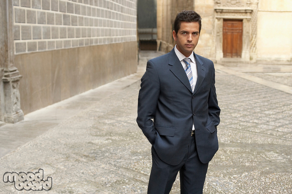 Businessman standing in street portrait.