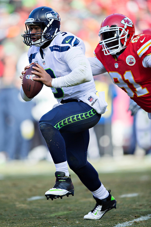 KANSAS CITY, MO - NOVEMBER 16:  Russell Wilson #3 of the Seattle Seahawks is tackled from behind by Tamba Hali #91 of the Kansas City Chiefs at Arrowhead Stadium on November 16, 2014 in Kansas City, Missouri.  The Chiefs defeated the Seahawks 24-20.  (Photo by Wesley Hitt/Getty Images) *** Local Caption *** Russell Wilson; Tamba Hali