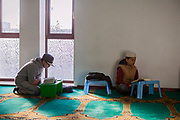 Youngsters of the Islamic community are studying the Koran in Birmingham Central Mosque.