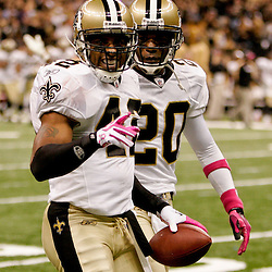 2009 October 04: New Orleans Saints safety Darren Sharper (42) celebrates with teammate Randall Gay (20) after recording his second interception on the game during a 24-10 win by the New Orleans Saints over the New York Jets at the Louisiana Superdome in New Orleans, Louisiana.