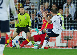 CARDIFF, WALES - Friday, October 12, 2012: Wales' captain Ashley Williams blocks a shot from Scotland's Steven Fletcher during the Brazil 2014 FIFA World Cup Qualifying Group A match at the Cardiff City Stadium. (Pic by David Rawcliffe/Propaganda)