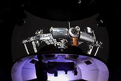 Stock photo of a man operating a NASA training simulator