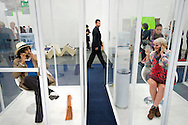 UK. London. The Frieze Art Fair in Reagent's Park.<br /> Photo shows people smoking in special smoking booths, a Frieze Project called 'Norma Jeane, The Straight Story'.