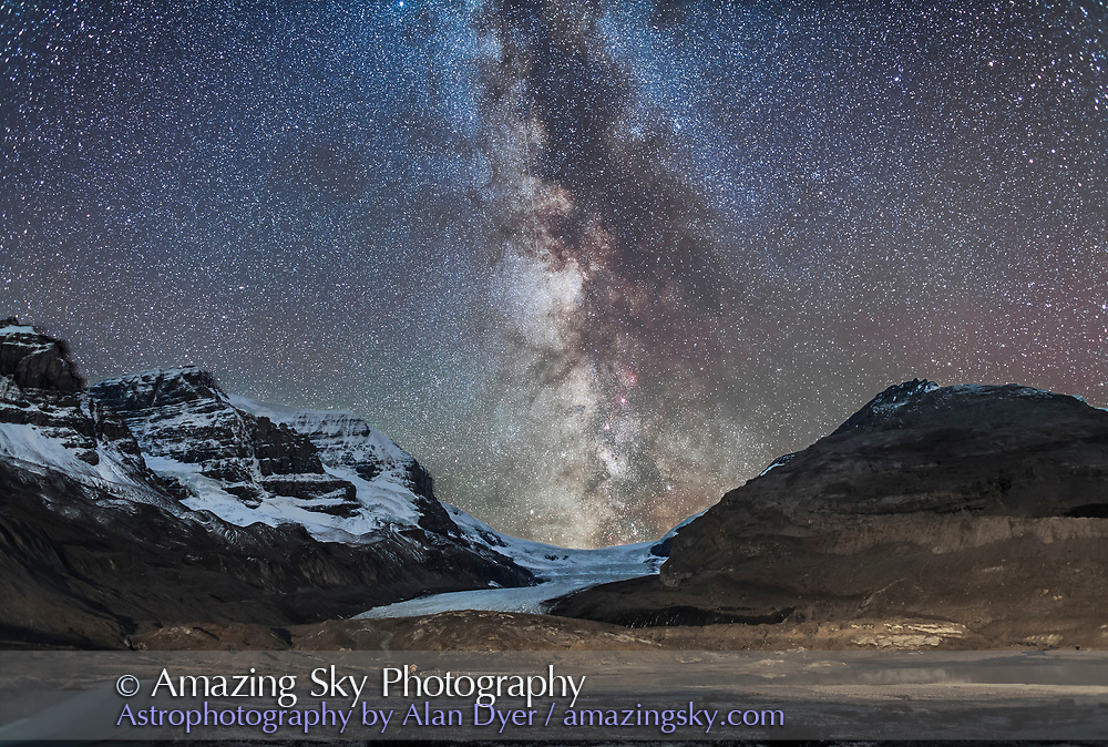 The Milky Way over Athabasca Glacier at the Columbia Icefields in Jasper National Park, Sept 14, 2014 on a very clear night before moonrise. The centre of the Galaxy area in Sagittarius is setting in the southwest behind the Icefields. The foreground light on the moraines is wash from lights on the Glacier View Inn and Icefields Centre. Other ground illumination on the peaks is from starlight. Mt. Andromeda is at left. <br /><br />This is a composite of 4 shots, tracked, for the sky, blended in Lighten mode and 4 shots, untracked, for the ground, blended in Mean combine mode to reduce noise. The trailed sky is masked out of the ground shots and the trailed ground is masked out of the sky shots, so both ground and sky are sharp but the sky has the benefit of the longer exposures required to really bring out Milky Way details. Each sky shot was 3 minutes and each ground shot was 4 minutes, all at f/2.5 with the 24mm lens and Canon 6D at ISO 1250. Tracked on the Sky-Watcher Star Adventurer, with the drive turned off for the ground images at the end of the sky exposures.