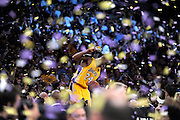 Confetti falls as Kobe Bryant celebrates on top of the scorers table after the game. The Lakers defeated the Boston Celtics in game 7 of the NBA Finals  83-79 in Los Angeles, CA 06/16/2010 (John McCoy/Staff Photographer).