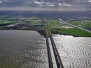 Nederland, Zuid-Holland, Hollands Diep, 25-02-2020; Hollandsch Diep, de grens tussen Brabant en Zuid-Holland met spoorbruggen: Moerdijkspoorbrug en HSL-brug. Rechts de brug voor het autoverkeer, A16. Aan de horizon een regenbui.<br /> Railwaybridges across Hollandsch Diep.<br /> <br /> luchtfoto (toeslag op standard tarieven);<br /> aerial photo (additional fee required)<br /> copyright © 2020 foto/photo Siebe Swart