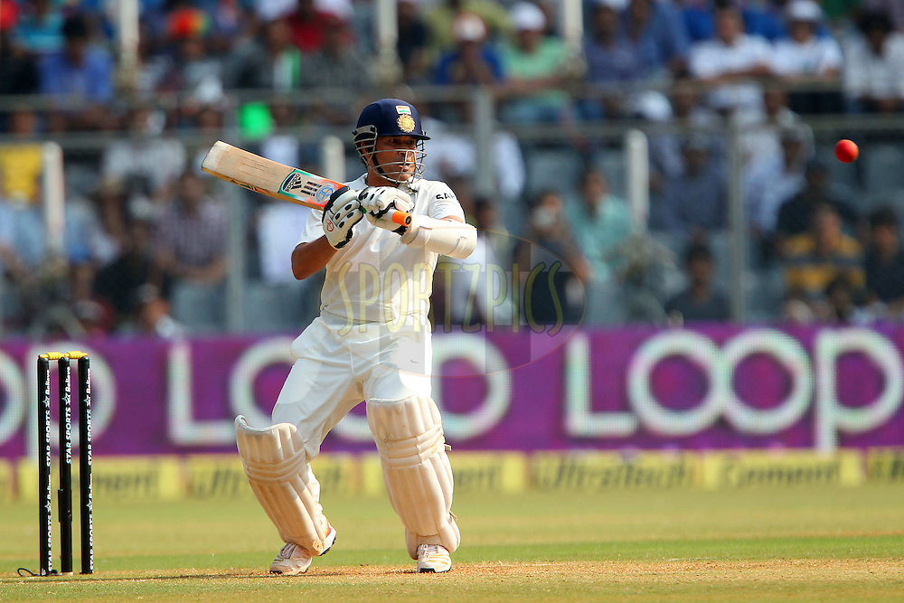 Sachin Tendulkar of India lines up a high ball during day two of the second Star Sports test match between India and The West Indies held at The Wankhede Stadium in Mumbai, India on the 15th November 2013<br /> <br /> This test match is the 200th test match for Sachin Tendulkar and his last for India.  After a career spanning more than 24yrs Sachin is retiring from cricket and this test match is his last appearance on the field of play.<br /> <br /> <br /> Photo by: Ron Gaunt - BCCI - SPORTZPICS<br /> <br /> Use of this image is subject to the terms and conditions as outlined by the BCCI. These terms can be found by following this link:<br /> <br /> http://sportzpics.photoshelter.com/gallery/BCCI-Image-Terms/G0000ahUVIIEBQ84/C0000whs75.ajndY