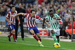 27.10.2013, Estadio Vicente Calderon, Madrid, ESP, Primera Division, Atletico Madrid vs Real Betis, 10. Runde, im Bild Atletico de Madrid's Juanfran (C) and Real Betis Cedrick (R) // Atletico de Madrid's Juanfran (C) and Real Betis Cedrick (R) during the Spanish Primera Division 10th round match between Club Atletico de Madrid and Real Betis at the Estadio Vicente Calderon in Madrid, Spain on 2013/10/28. EXPA Pictures © 2013, PhotoCredit: EXPA/ Alterphotos/ Victor Blanco<br /> <br /> *****ATTENTION - OUT of ESP, SUI*****