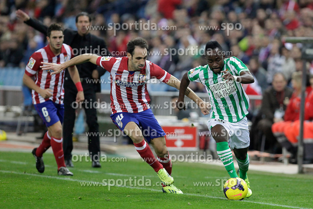 27.10.2013, Estadio Vicente Calderon, Madrid, ESP, Primera Division, Atletico Madrid vs Real Betis, 10. Runde, im Bild Atletico de Madrid's Juanfran (C) and Real Betis Cedrick (R) // Atletico de Madrid's Juanfran (C) and Real Betis Cedrick (R) during the Spanish Primera Division 10th round match between Club Atletico de Madrid and Real Betis at the Estadio Vicente Calderon in Madrid, Spain on 2013/10/28. EXPA Pictures &copy; 2013, PhotoCredit: EXPA/ Alterphotos/ Victor Blanco<br /> <br /> *****ATTENTION - OUT of ESP, SUI*****