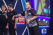 Kim Huybrechts reaction after missing a dart at a double during the PDC William Hill Darts World Championship at Alexandra Palace, London, United Kingdom on 13 December 2019.