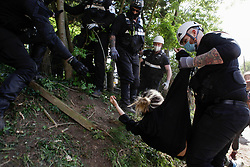 © Licensed to London News Pictures. 12/05/2020. Colne Valley, UK. Bailiffs forcibly remove an XR activist from the HS2 Colne Valley site at the start of an eviction of environmental activists from Extinction Rebellion. Activists have chained themselves to the floor in an attempt to prevent the eviction. Photo credit: Marcin Nowak/LNP