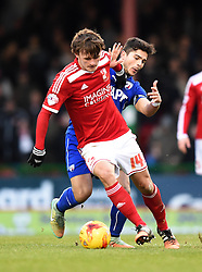 Swindon Town's John Swift is challenged by Chesterfield captain Sam Morsy in the Sky Bet League One match between Swindon Town and Chesterfield at The County Ground on January 17, 2015 in Swindon, England. - Photo mandatory by-line: Paul Knight/JMP - Mobile: 07966 386802 - 17/01/2015 - SPORT - Football - Swindon - The County Ground - Swindon Town v Chesterfield - Sky Bet League One