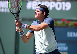 March 16, 2019 - Indian Wells, CA, U.S. - INDIAN WELLS, CA - MARCH 16: Milos Raonic (CAN) hits a backhand during the semifinals of the BNP Paribas Open on March 16, 2019, at the Indian Wells Tennis Gardens in Indian Wells, CA. (Photo by Adam Davis/Icon Sportswire) (Credit Image: © Adam Davis/Icon SMI via ZUMA Press)