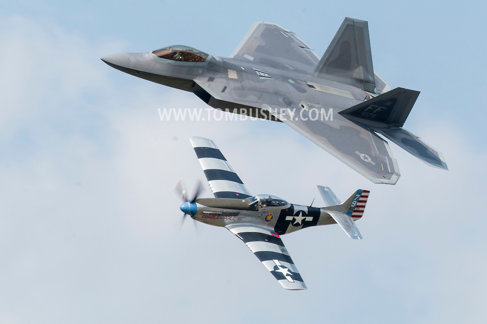 New Windsor, New York - A U.S. Air Force F-22 Raptor and a World War II P-51D Mustang fly on the USAF Heritage Flight at the New York Air Show at Stewart International Airport on Aug. 29, 2015. ©Tom Bushey / The Image Works