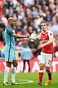 Arsenal defender Hector Bellerin (24), Manchester City defender Vincent Kompany (4) after the The FA Cup semi final match between Arsenal and Manchester City at the Emirates Stadium, London, England on 23 April 2017. Photo by Sebastian Frej.