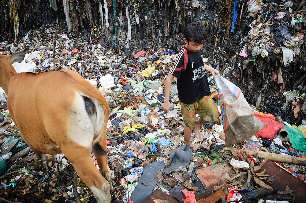Ashuar, 12, working in an older section of the 'Trash mountain', Makassar, Sulawesi, Indonesia.