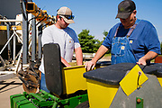 "06 AUGUST 2020 - FAIRFIELD, IOWA: JEFF KINKART, left, and BEN KINKART, both from Bloomfield, IA, look at a corn planter they planned to bid on before the auction on the Adam Farm near Fairfield. Gary Adam, 72 years old, has been farming in the Fairfield area since 1971. He decided to retire this year because he wants to travel and because it's so difficult to make money in farming this year. He said he wants to ""shed the risk and responsibility. If things were super good, like they were 2006-2012, I might stay in it, but they're not."" An increasing number of farmers in the Midwest are retiring this year as it becomes harder to make money on crops. In addition to low prices, Iowa farmers are being hit with a drought this year, with well below average rain over most of the state. Because of the COVID-19 pandemic, the auction on Adam's farm was one of the first live in person auctions since winter. Most auctions are now done on line.    PHOTO BY JACK KURTZ"