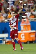FRISCO, TX - JUNE 12:  Zach Loyd #17 of FC Dallas waves to the fans after scoring a goal against the Houston Dynamo on June 12, 2013 at FC Dallas Stadium in Frisco, Texas.  (Photo by Cooper Neill/Getty Images) *** Local Caption *** Zach Loyd