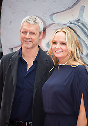 Neil Burger and his wife arrive for the European premiere of her latest film Divergent at Odeon LEICESTER SQUARE, London, United Kingdom. Sunday, 30th March 2014. Picture by Daniel Leal-Olivas / i-Images