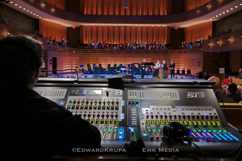 Looking over the shoulder of the sound mixer in Koerner Hall, part of the Royal Conservatory of Music's TELUS Centre for Performance and Learning.